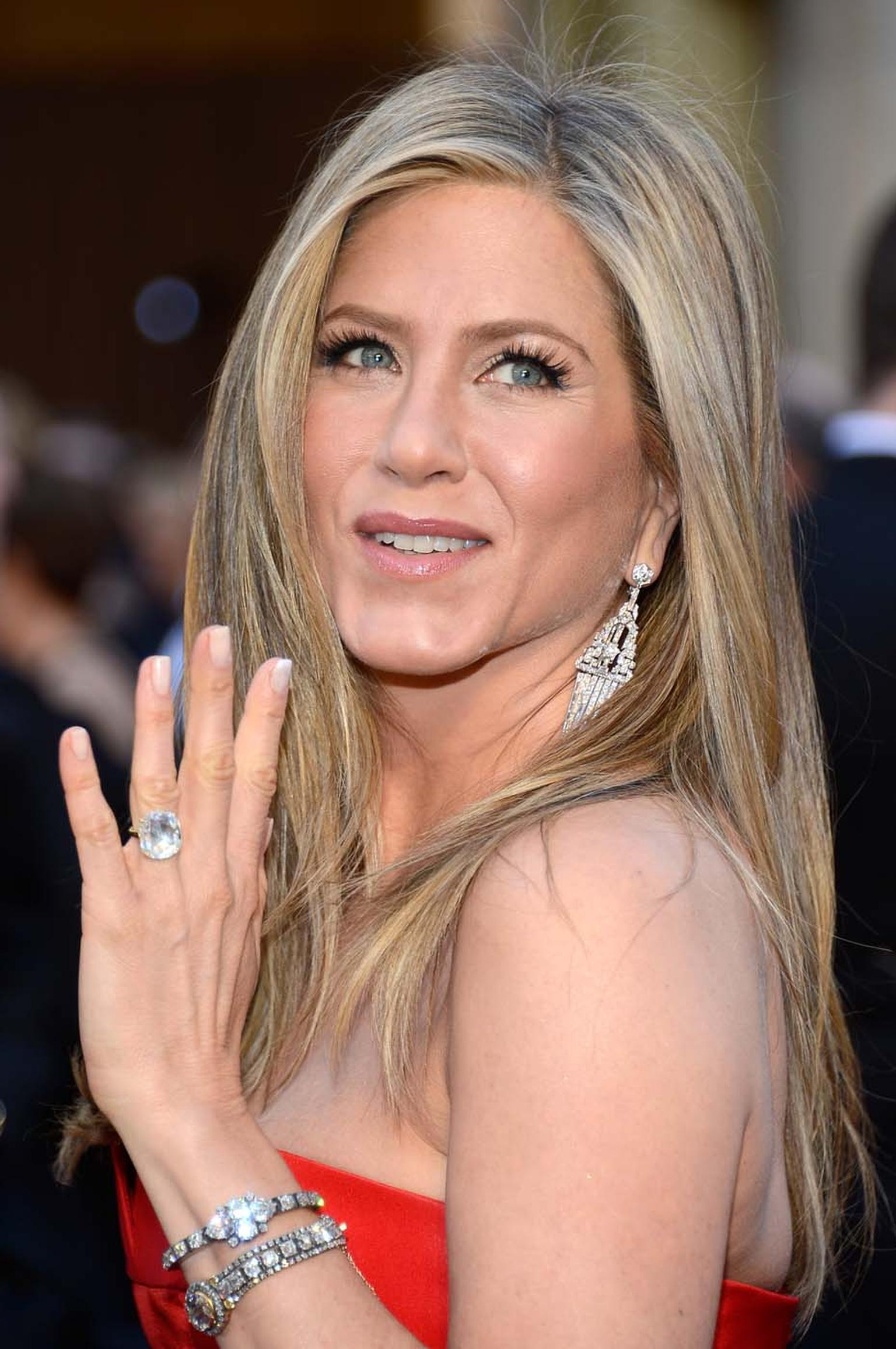 Rebecca Selva, chief creative officer and PR director for Fred Leighton, re-imagined an Art Deco diamond dress clip into dramatic earrings for Jennifer Aniston at the 2013 Oscars.