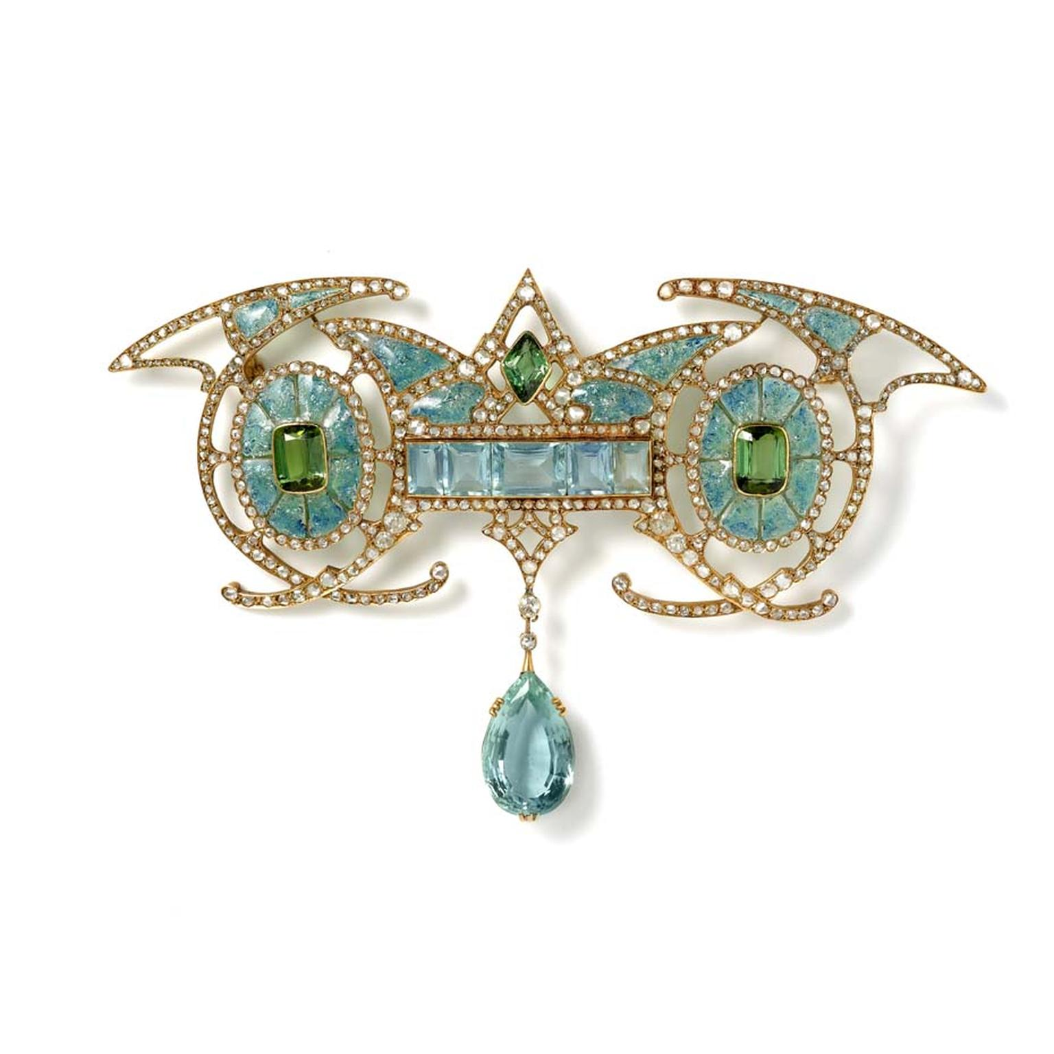 Art Nouveau yellow gold brooch designed with a central aquamarine panel carrying an aquamarine drop, set between two green tourmalines, within enamelled ovals with diamonds, by Georges Fouquet, Paris. Available at Hancocks.