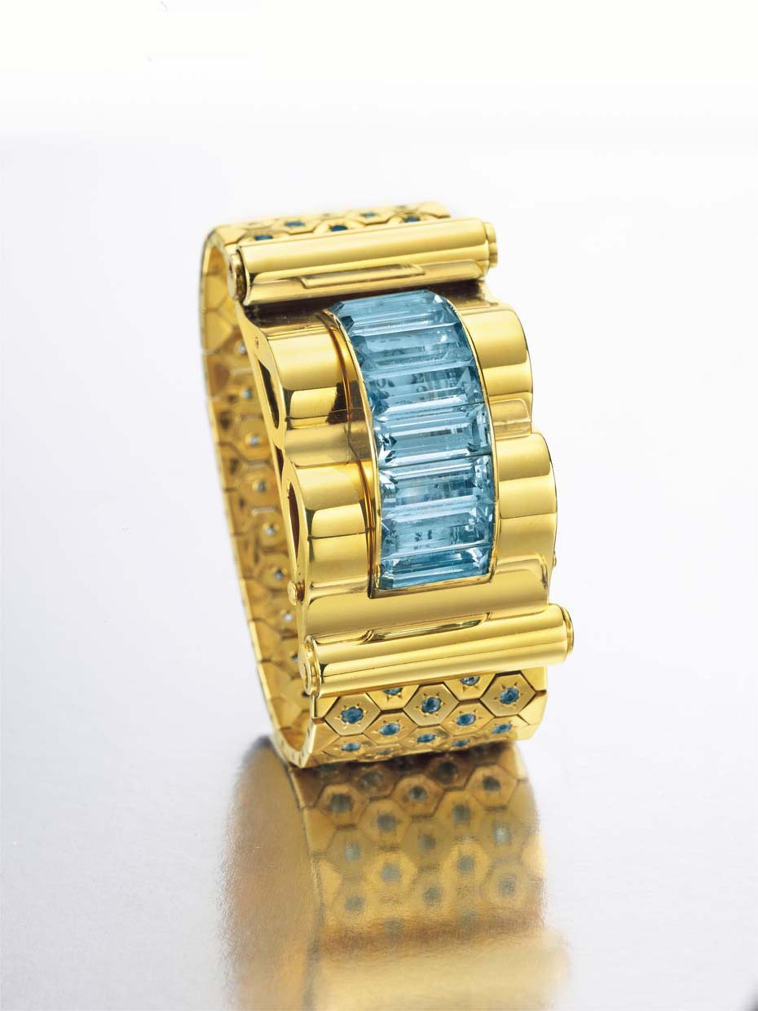 This Van Cleef & Arpels Ludo Hexagone bracelet watch in gold and aquamarine sold for US$68,750 at Christie's New York in 2014.