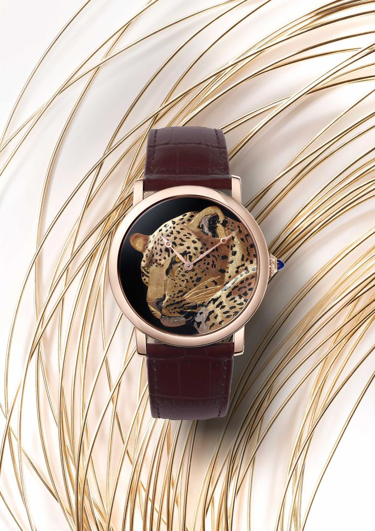 Rotonde de Cartier 42mm rose gold watch features a solitary panther brought to life thanks to the art of damascening in which different colours of gold wire are hammered into the spaces cut into the gold dial to create the feline's supple golden coat. (Ni