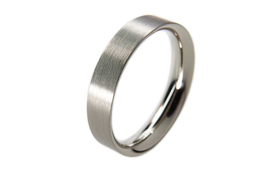 Unity wedding ring in platinum from Cox & Power.