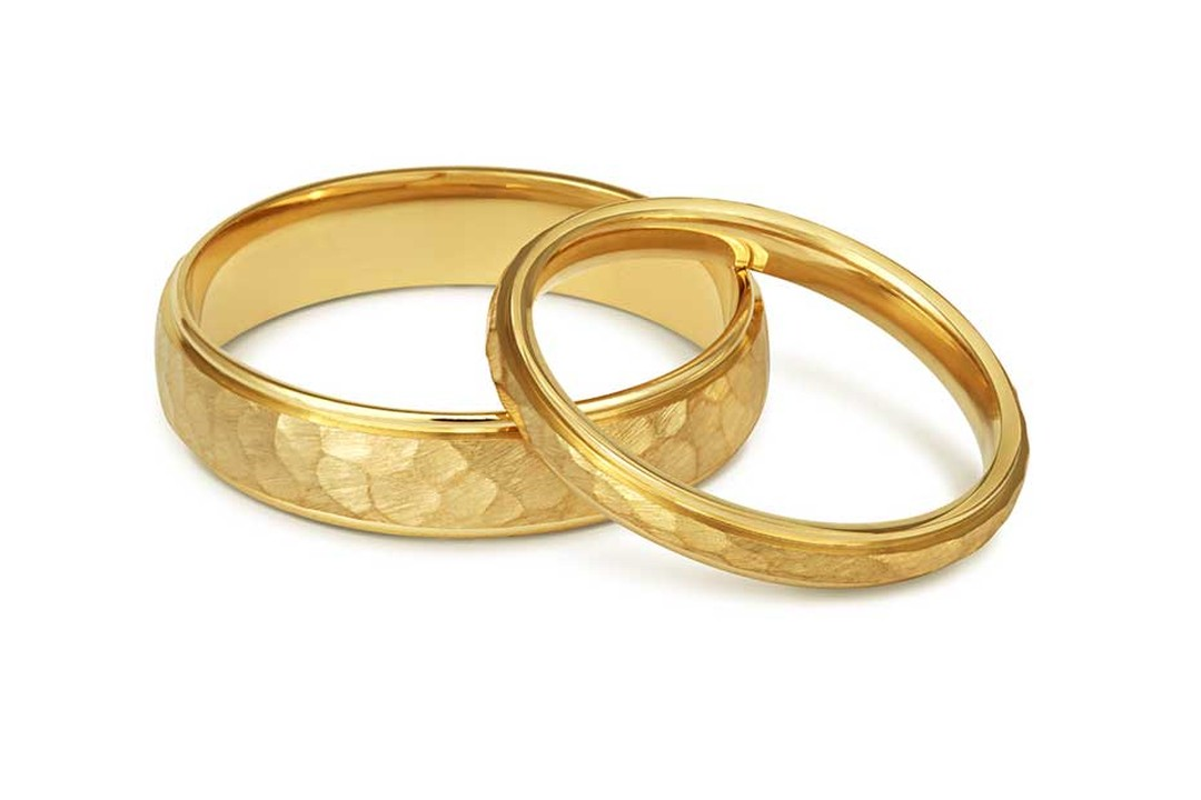 Court Hammered Wedding Rings for him and her in Fairtrade yellow gold from Cred jewellery.