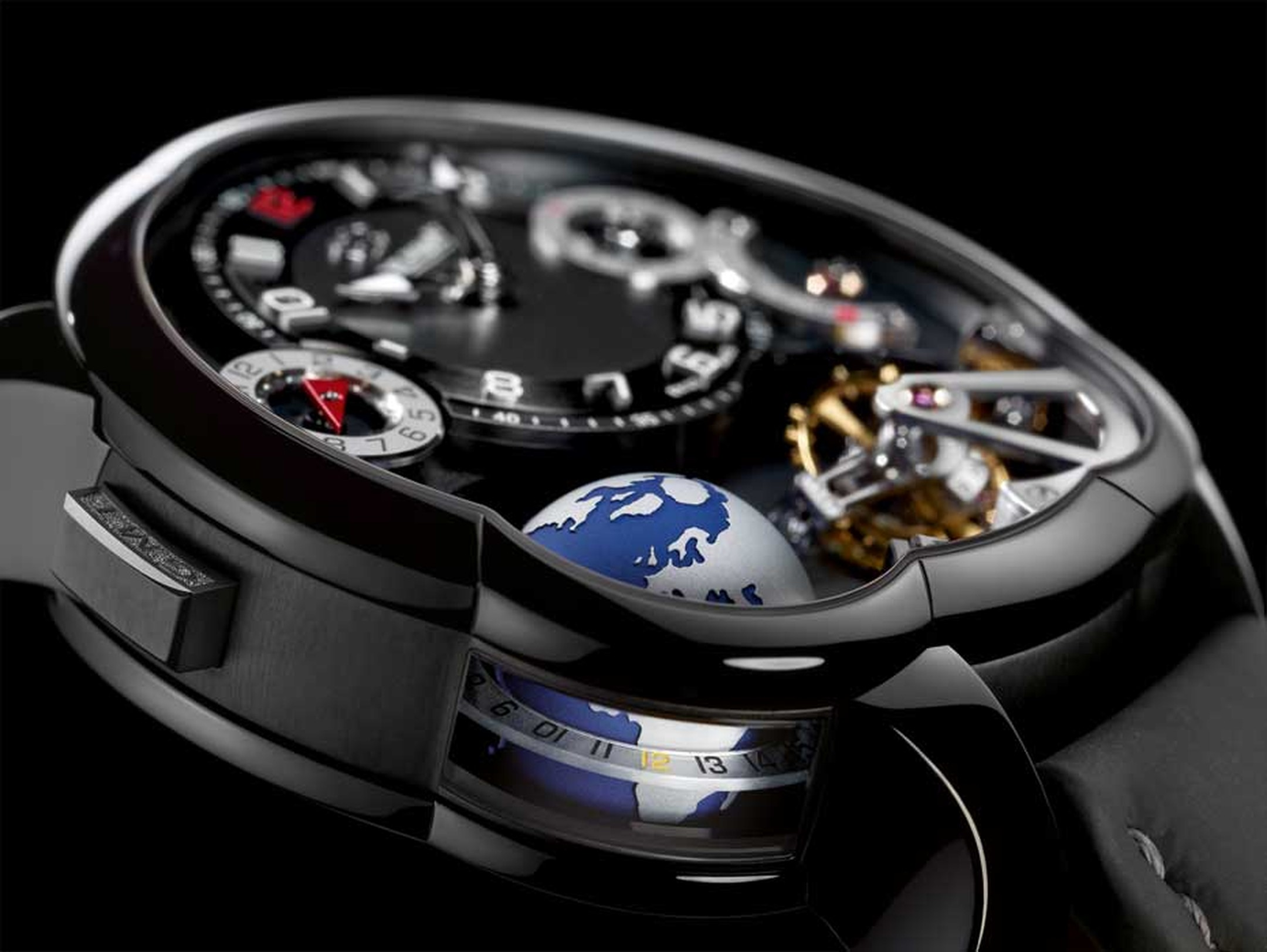 Greubel Forsey GMT is housed in a lightweight titanium case with a black ADLC coating. The 3D globe completes a rotation every 24 hours and gets extra light from the lateral window on the case. The inclined 24-second tourbillon is a house speciality.