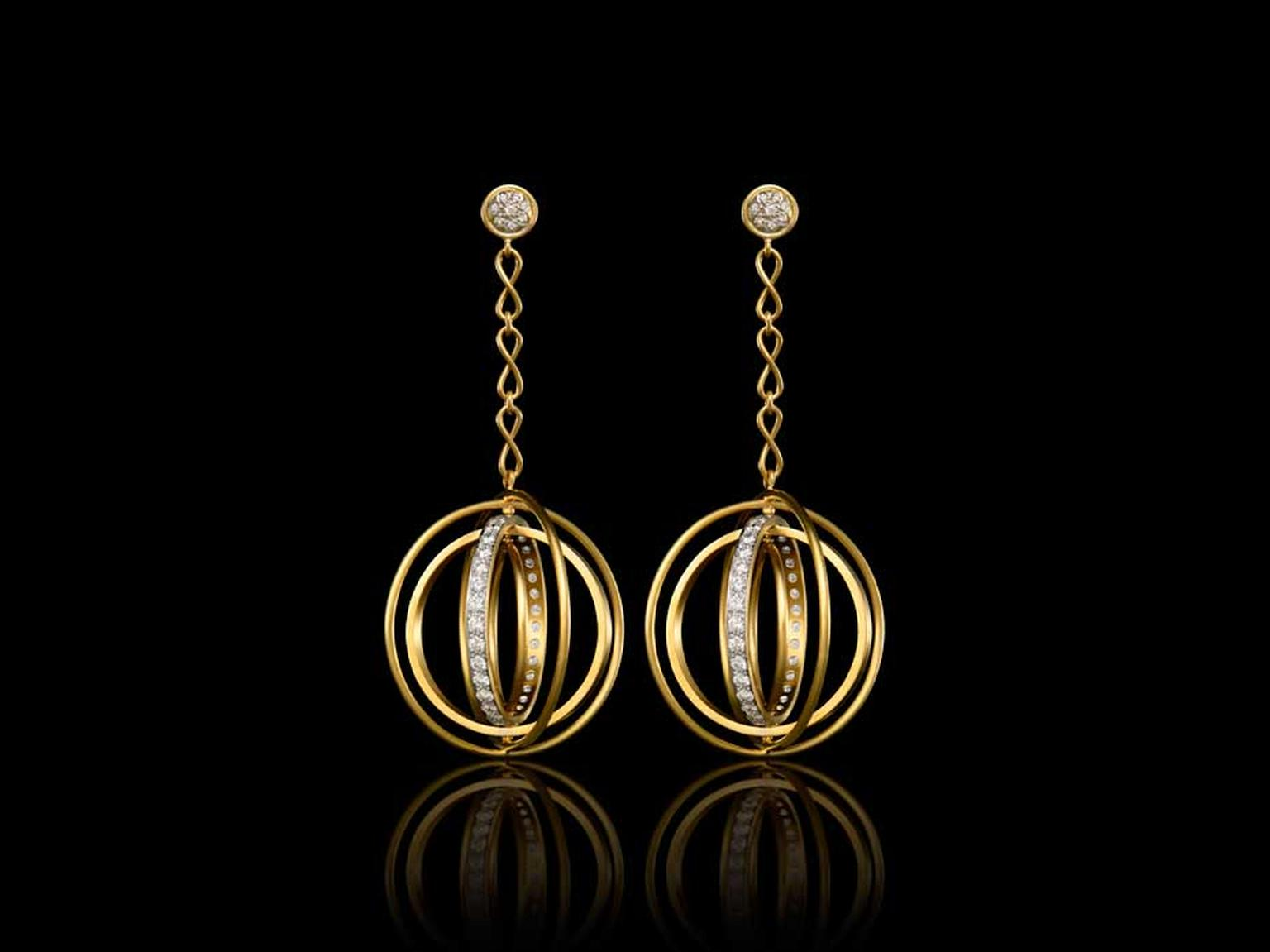 Liv Ballard Collection Orrechini Cerchi Piroetta Spinning Hoop earrings in yellow gold with diamonds.
