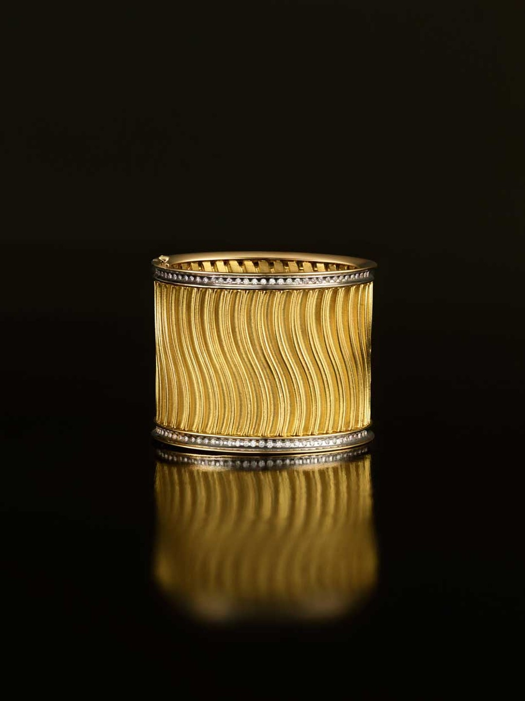 Liv Ballard Collection Cisterna Cuff in pleated yellow gold with pavé diamonds.