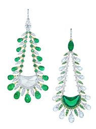 Also on show at DJWE will be this pair of Moussaieff high jewellery earrings set with a half moon Colombian emerald and a half moon diamond.
