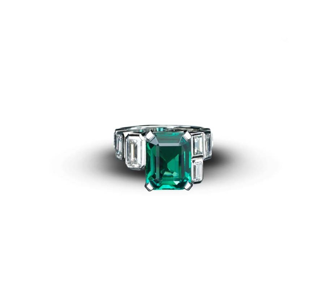 Emerald Art Deco Style ring from Star Diamond, with a central African emerald, weighing 5.9cts, flanked with white emerald cut diamonds of 2.73cts set in white gold.