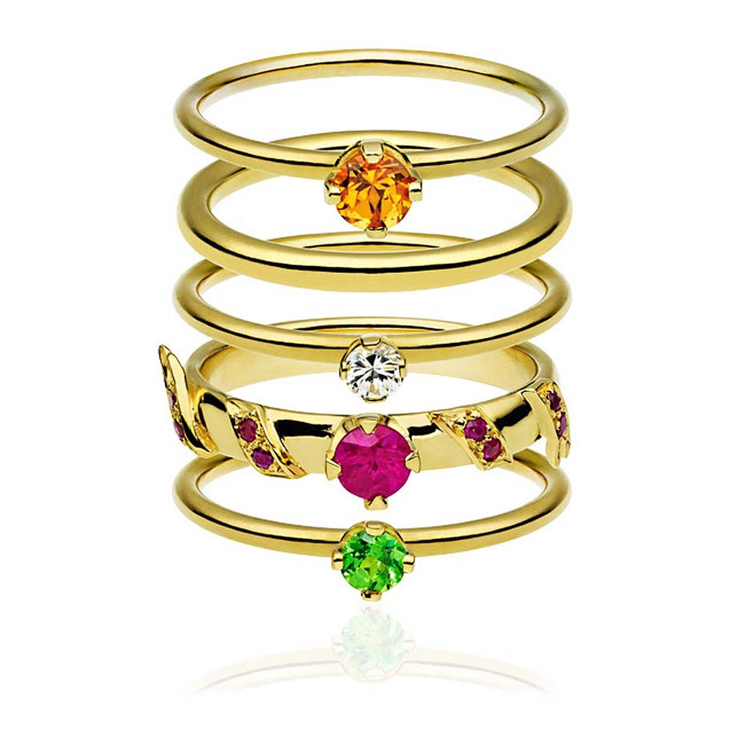 Ana de Costa Alchemy gemstone stacking rings in yellow gold featuring a round brilliant-cut mandarin garnet, a brilliant-cut diamond, brilliant-cut rubies and a brilliant-cut tsavorite,£2,950.