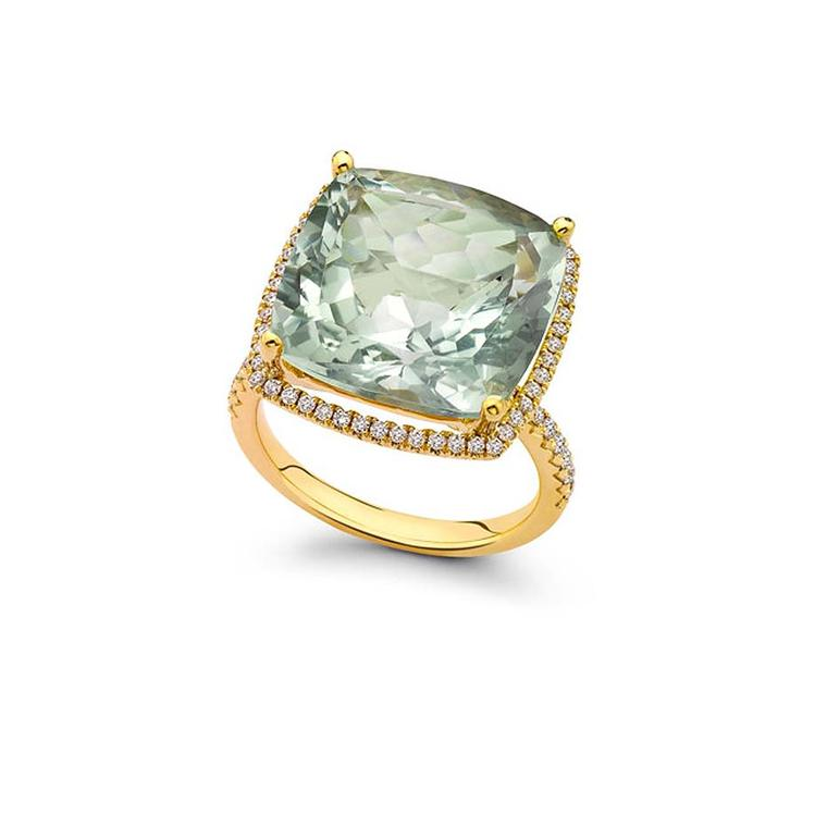Kiki McDonough Grace green amethyst cushion ring in yellow gold features a cushion-cut pale green amethyst  surrounded by pavé-set diamonds. £2900.