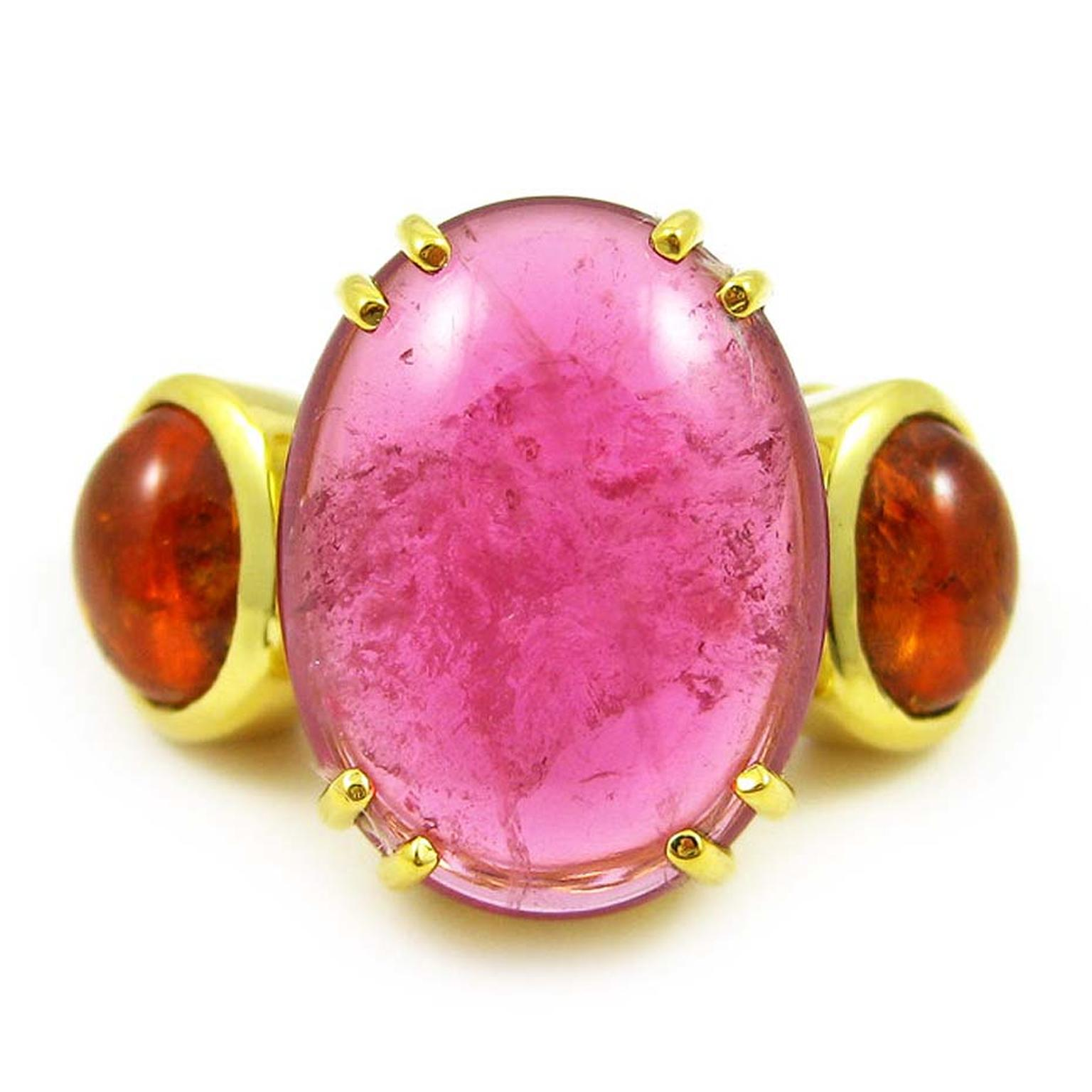 From the Chains of Love collection, the K Brunini Jewels rubellite and mandarin garnet Twig ring in yellow gold is set with a large pink rubellite with a mandarin garnet cabochon on either side. $14,800.