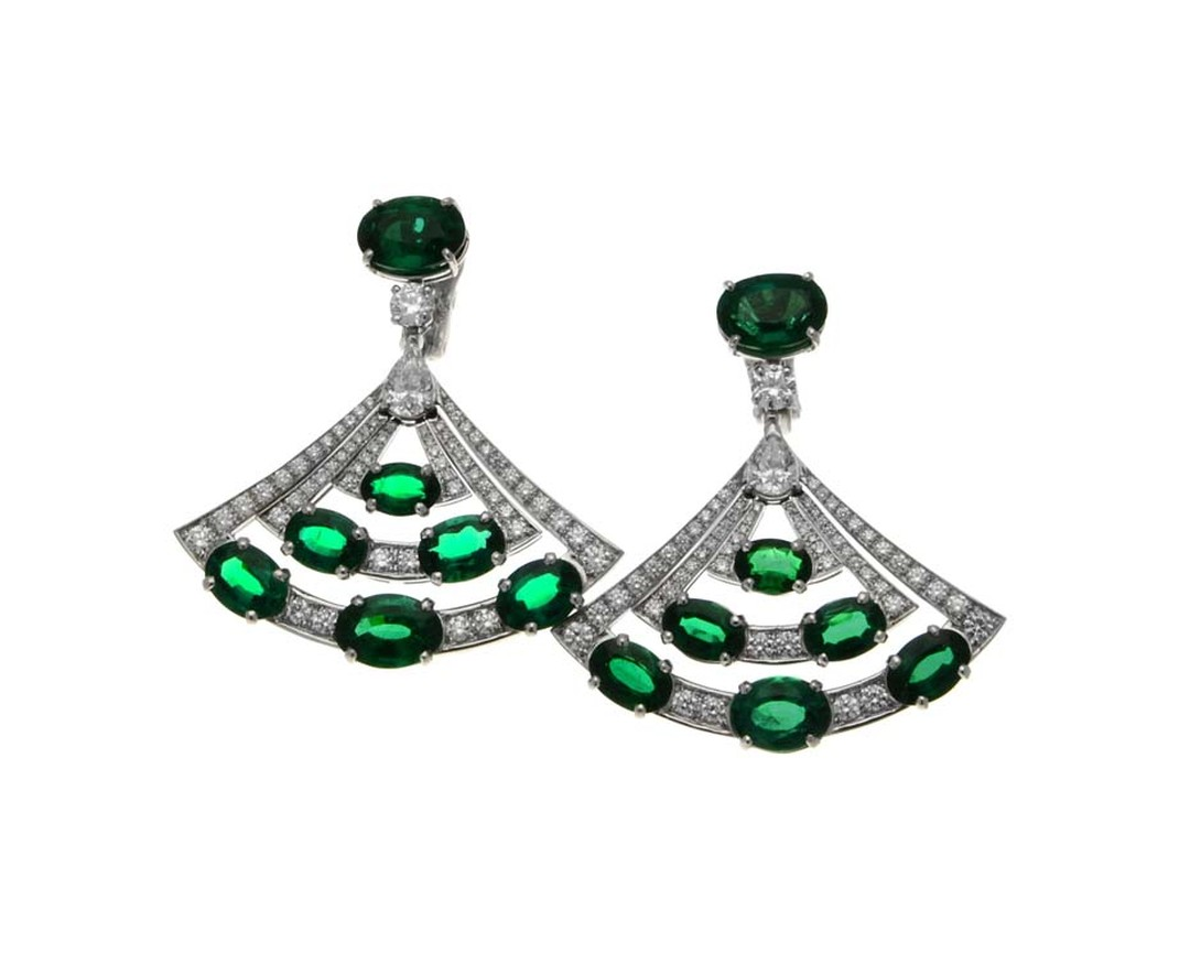Bulgari High Jewellery emerald earrings in platinum featuring 14 oval-shaped Zambian  emeralds, pear-shaped diamonds, round brilliant-cut diamonds and pavé diamonds.