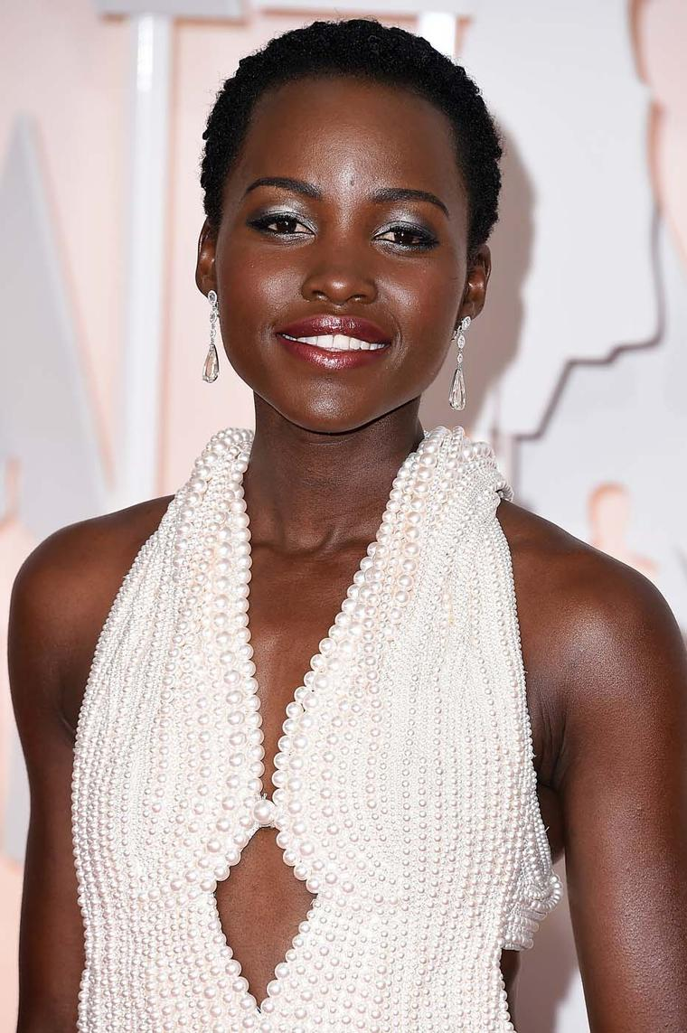 Actress Lupita Nyong'o walked the Oscars red carpet wearing a pair of Chopard diamond earrings featuring pear-shaped and rose-cut diamonds and three Chopard diamond rings, which added extra sparkle to her pearl-embellished Calvin Klein dress.