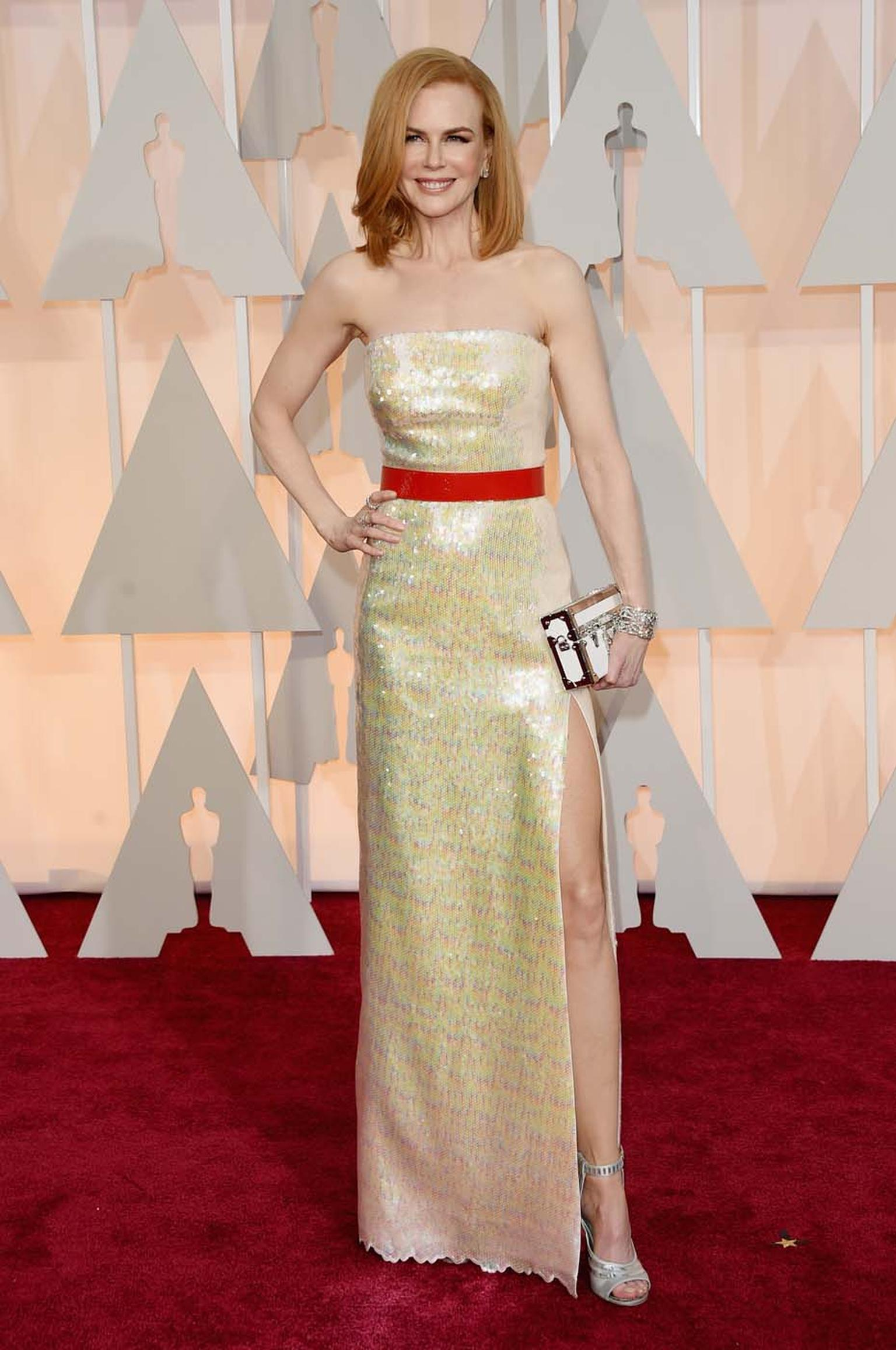 Nicole Kidman wore $7 million of red carpet jewelry to the Oscars. Her diamond ear studs, 82 carat diamond high jewelry bracelet, 16.5 carat diamond solitaire ring and a smaller diamond band ring, all by Harry Winston, complemented her Chanel dress perfec