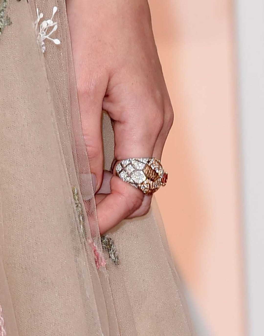 Actress Keira Knightley added this Chanel ring to her Oscars red carpet jewelry, perfectly complementing her dreamy, floral embroidered Valentino gown.