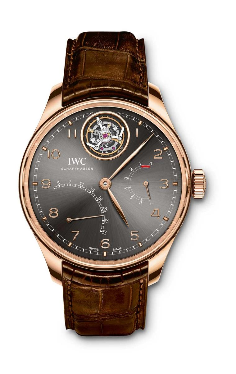 IWC Portugieser Tourbillon Mystère Rétrograde watch features a flying tourbillon at 12 o'clock floating in mid-air and a retrograde date display. The slate-coloured dial is offset by the warm 42.2mm rose gold case.