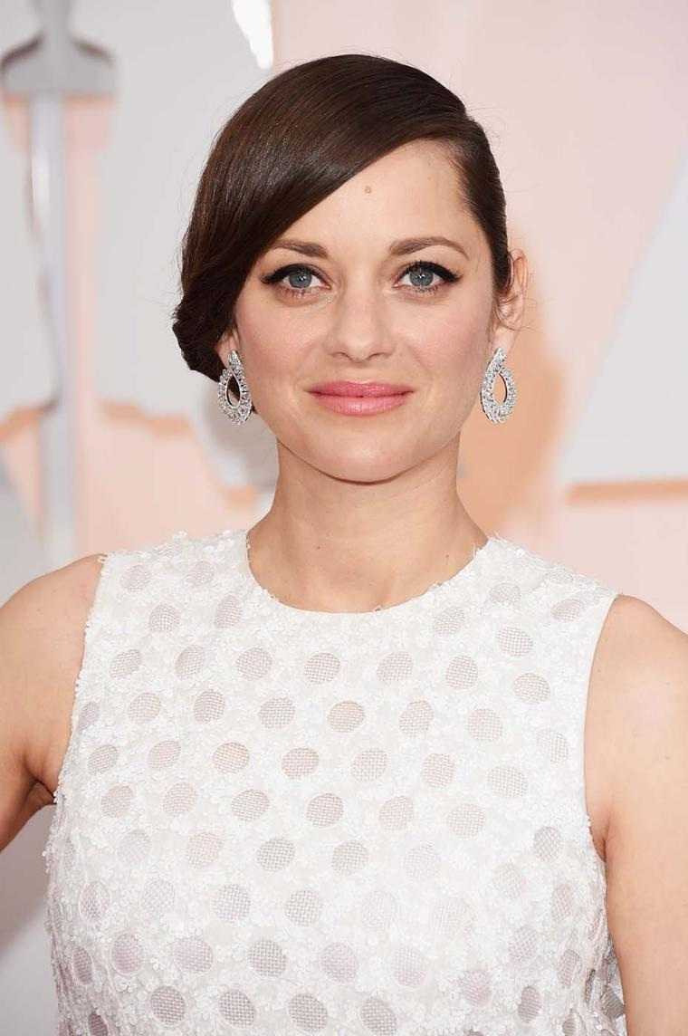 Best Actress nominee, Marion Cotillard chose a pair of sculptural diamond Chopard earrings to accessorize her opinion-dividing, polka dot-style Dior dress.