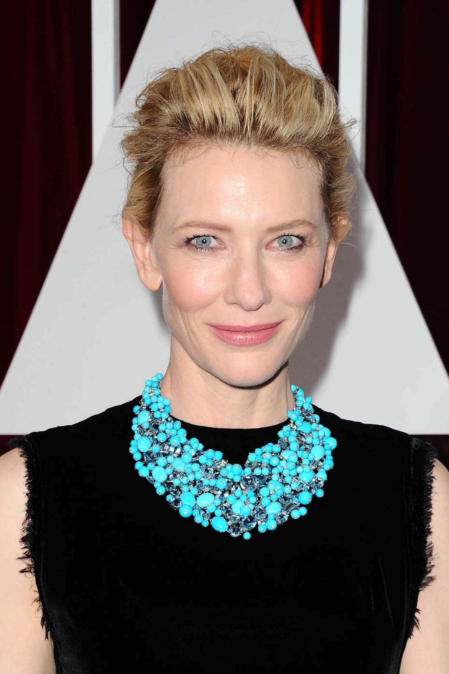 Actress Cate Blanchett's red carpet jewelry made one of the biggest statements of the night. She teamed her black Maison Margiela Couture gown with an outsized Tiffany bib of turquoise, aquamarine and diamonds.