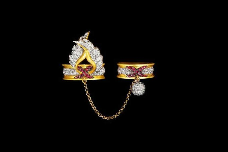 Liv Ballard Sacro Vincolo Alato yellow gold and diamond linked rings with ruby accents.