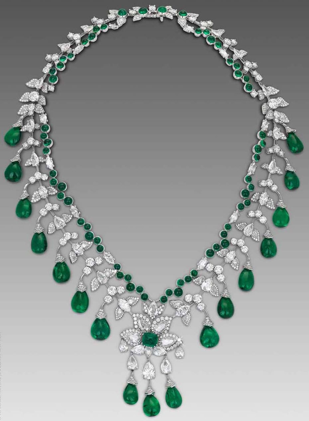 Zambian cabochon emerald necklace by David Morris in white gold.