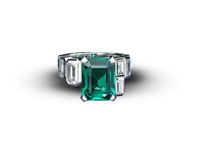 Art Deco-style emerald ring from Star Diamond, with a central African emerald weighing 5.90ct, flanked by 2.73ct emerald-cut diamonds in white gold.