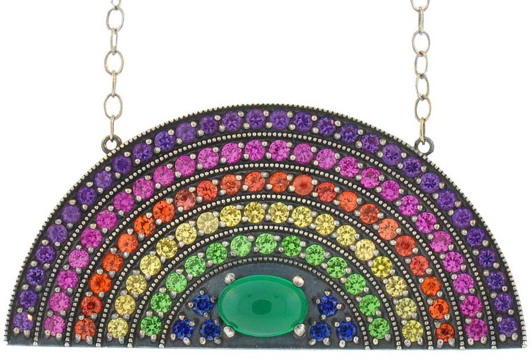 Andrea Fohrman rainbow pendant with stripes of coloured stones arched over a cabochon-cut green onyx. $5,500.
