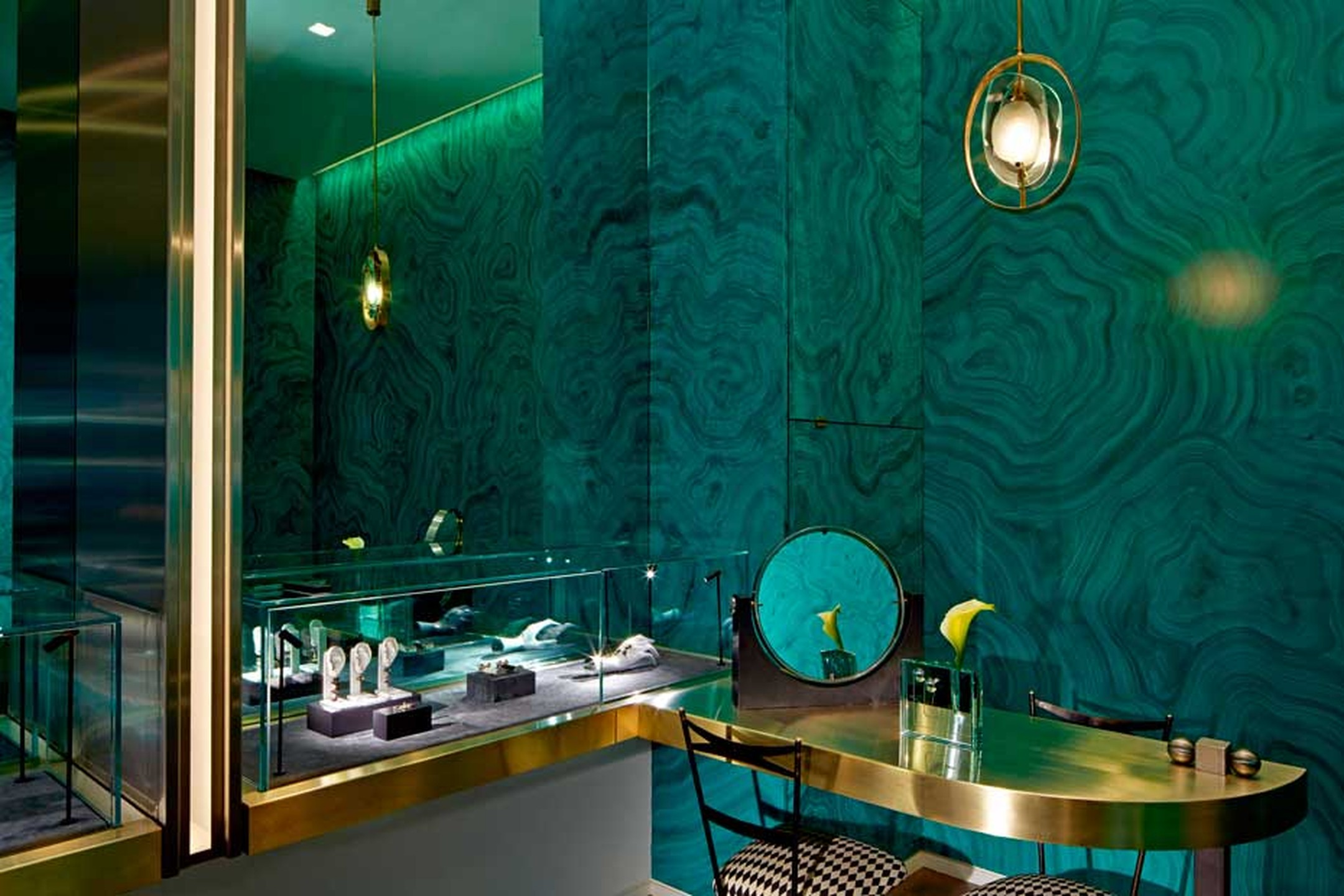 The walls of the boutique are lined in green mirrors, and elsewhere there is a mix of materials and textures including polished stainless steel, satin brass, fur and malachite green faux leather.