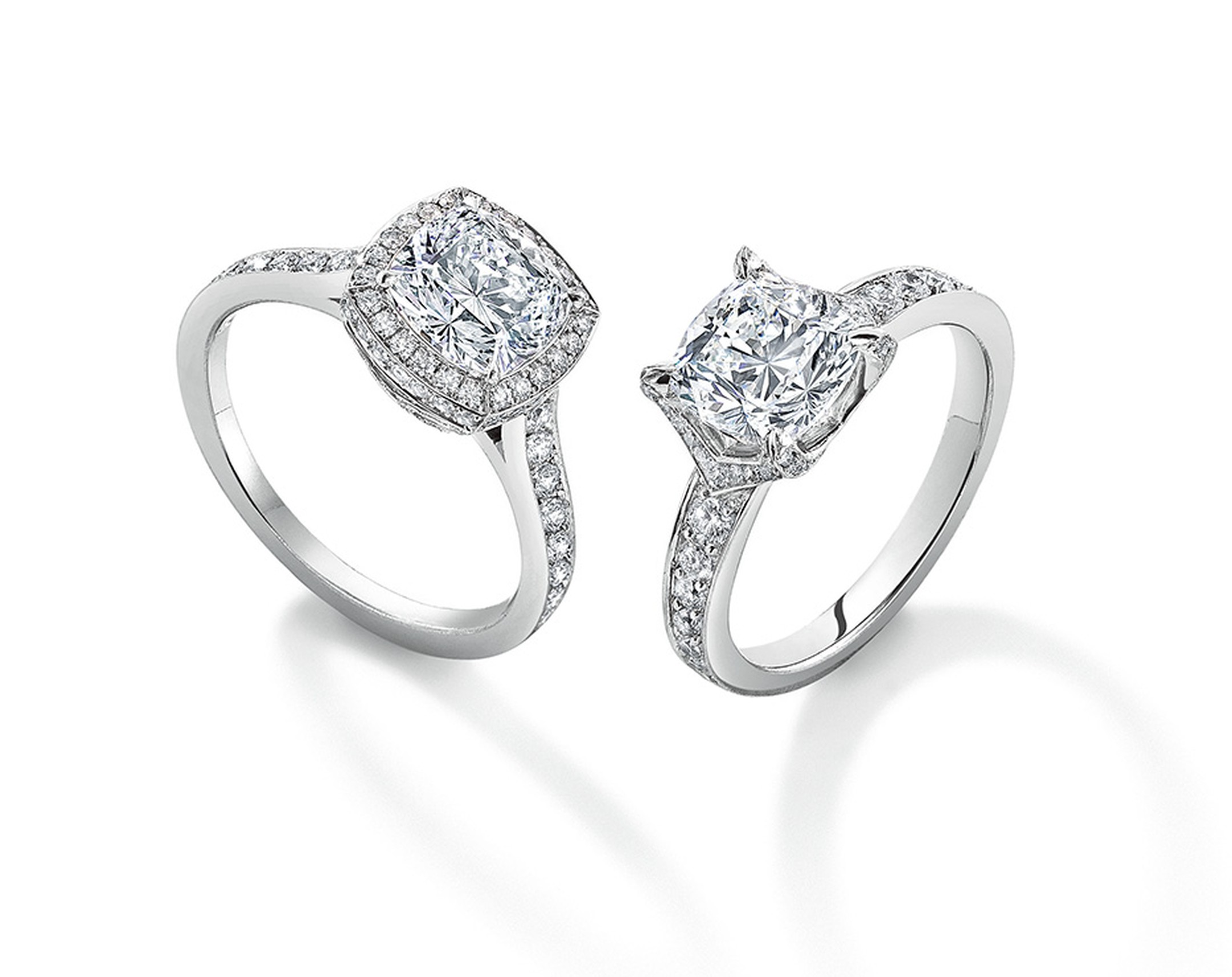 Asprey-cut diamond engagement rings with a micro-set diamond surround and pavé diamond V setting.
