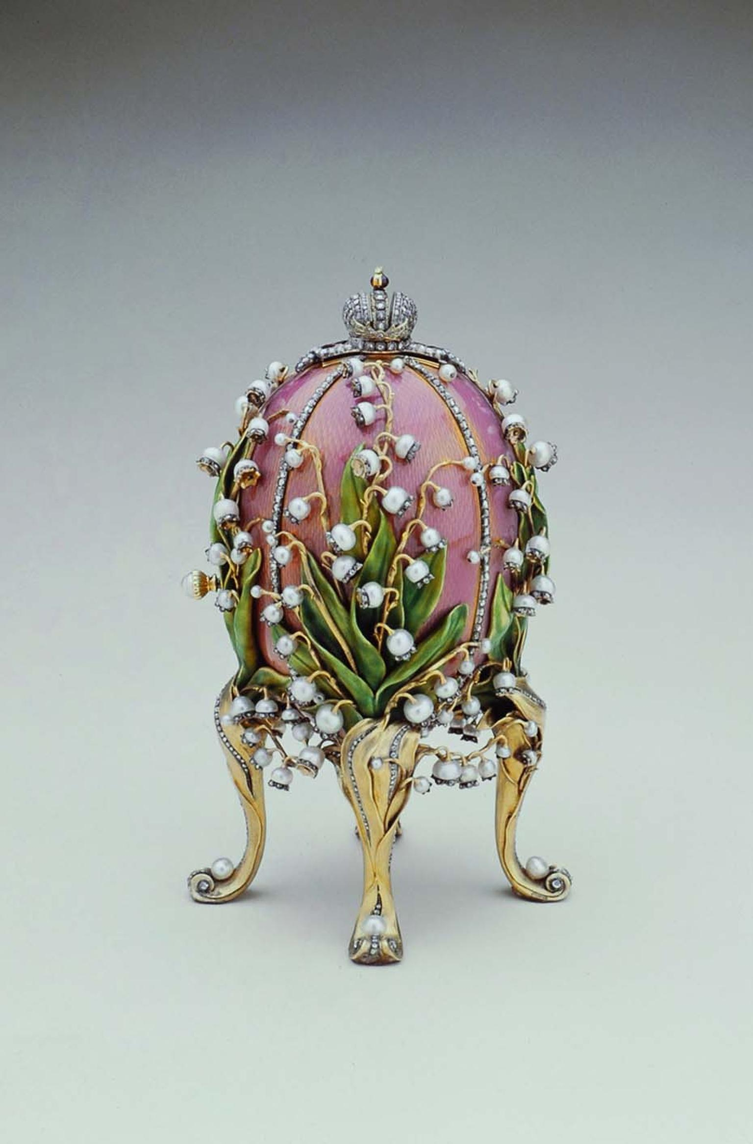 Tsar Nicholas II presented Empress Alexandra with this Fabergé Lilies of the Valley Egg. Made of gold, overlaid with translucent rose pink enamel, the beautiful creation is decorated with enamelled green leaves and pearls, complete with rose-cut diamond d