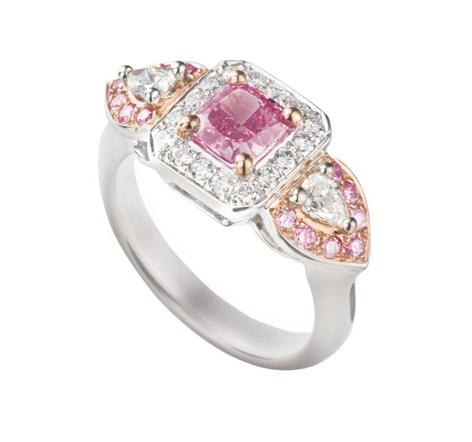 James Thredgold Pink Prosperity ring, featuring an 0.85ct radiant-cut Intense Pink Argyle diamond set within a white diamond halo. The hero gem is nestled within two pear-shape diamonds surrounded by a halo of pink Argyle diamonds in white gold. Available