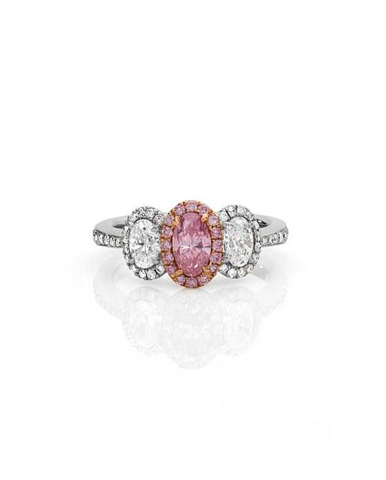 Cerrone Insieme Argyle pink diamond ring in white and rose gold with an oval Argyle pink diamond and oval white diamonds.