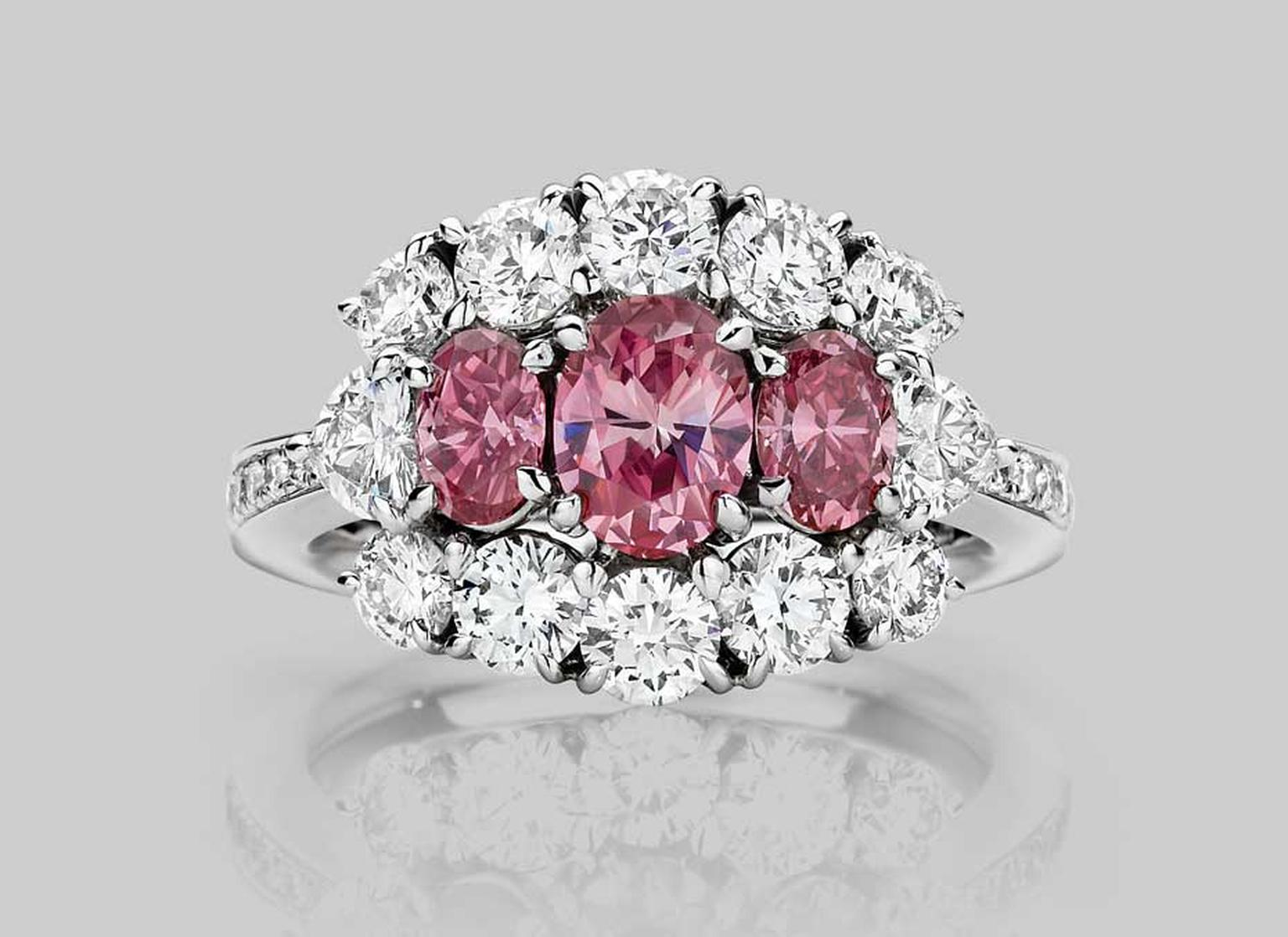 J. Farren-Price Trilogy 70th anniversary ring, with a trio of gems that feature a 0.59ct vivid purple pink, oval-cut Argyle diamond in the centre. Available at www.jfarrenprice.com.au.