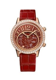 Jaeger-LeCoultre Rendez-Vous Celestial watch recreates the fire of the Sun with a dial made from Bordeaux-coloured aventurine, a stone that changes colour depending on the light. Just below the hour crescent is an elliptical disc featuring the 12 Zodiac s