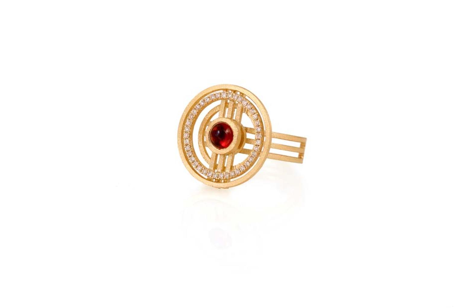 Shimell & Madden ring from the Orb collection in yellow gold with deep red cabochon garnets, orange sapphires and diamonds.