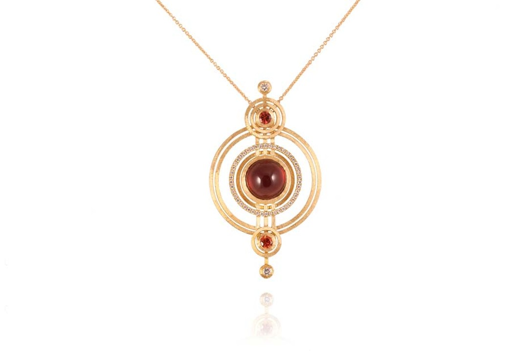 Shimell & Madden necklace from the Orb collection in yellow gold with deep red cabochon garnets, orange sapphires and diamonds.