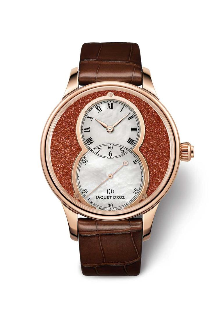 Jaquet Droz Grande Seconde Sunstone watch is characterised by its overlapping dials forming a figure eight. The outer Sunstone dial is offset by a white mother-of-pearl subdial, which indicates the small seconds. Presented in a 39mm rose gold case, this w