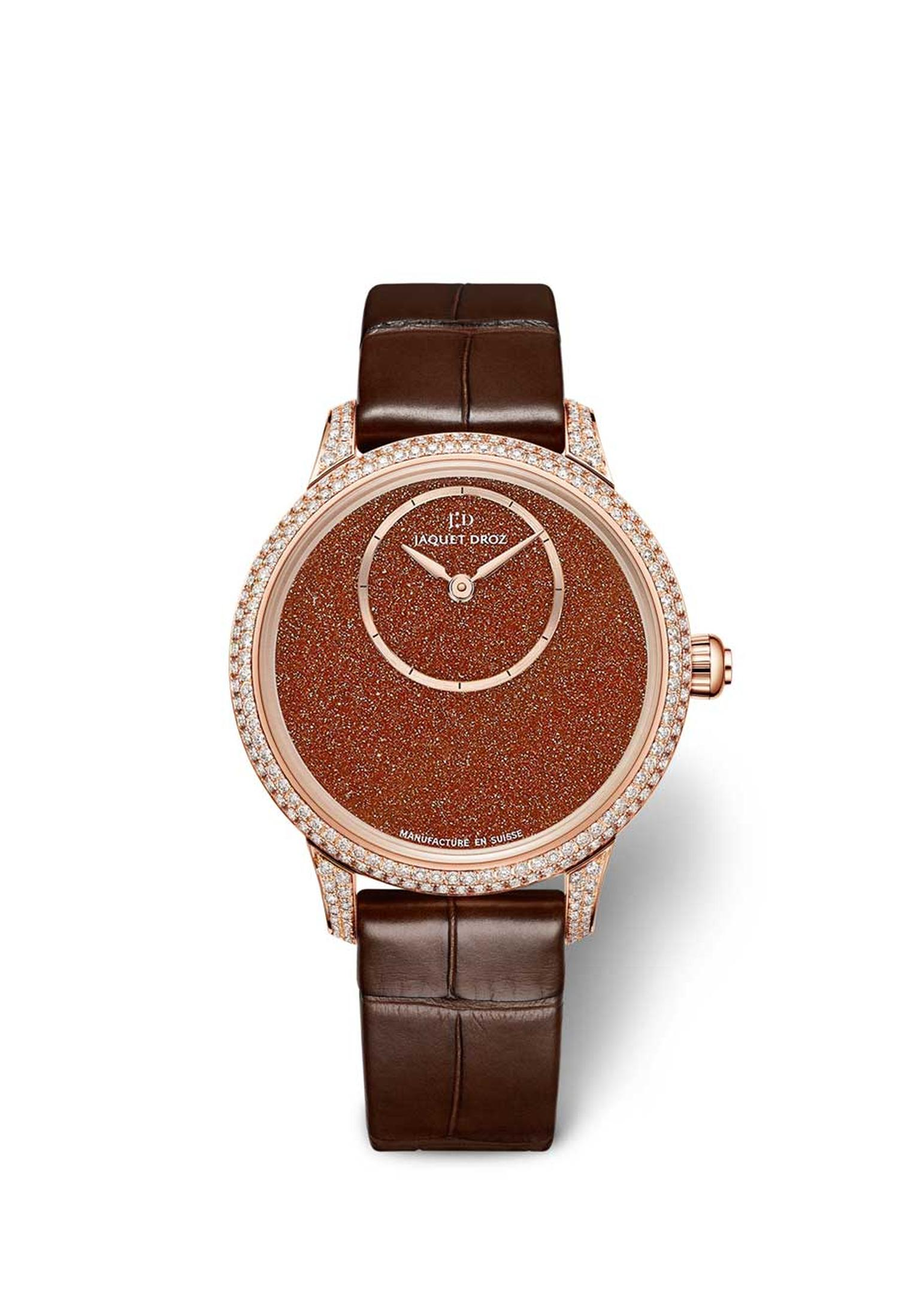 Jaquet Droz Petite Heure Minute Sunstone watch with a Sunstone dial, off-centred hours and minutes disc, and a 35mm rose gold case set with 232 diamonds. Limited edition of 88 pieces.