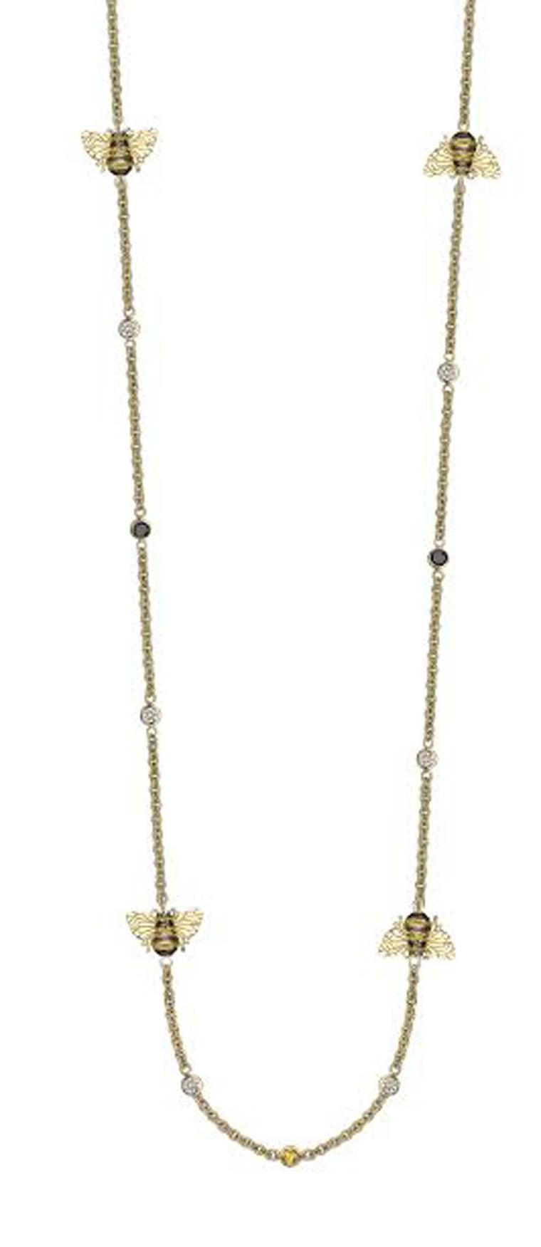 Theo Fennell bee necklace in yellow gold, with black and white diamonds and yellow sapphires.