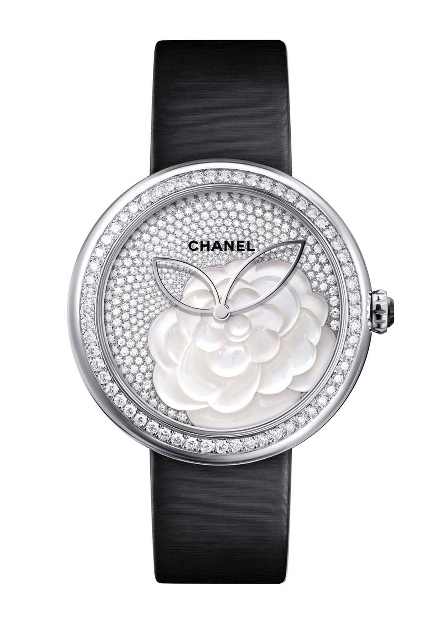 Chanel Mademoiselle Privé Camellia watch features a hand-crafted camellia flower on the dial. The layered mother-of-pearl discs create a billowing flower, which is then surrounded by 330 brilliant-cut diamonds, giving this perfect Mother's Day gift that e