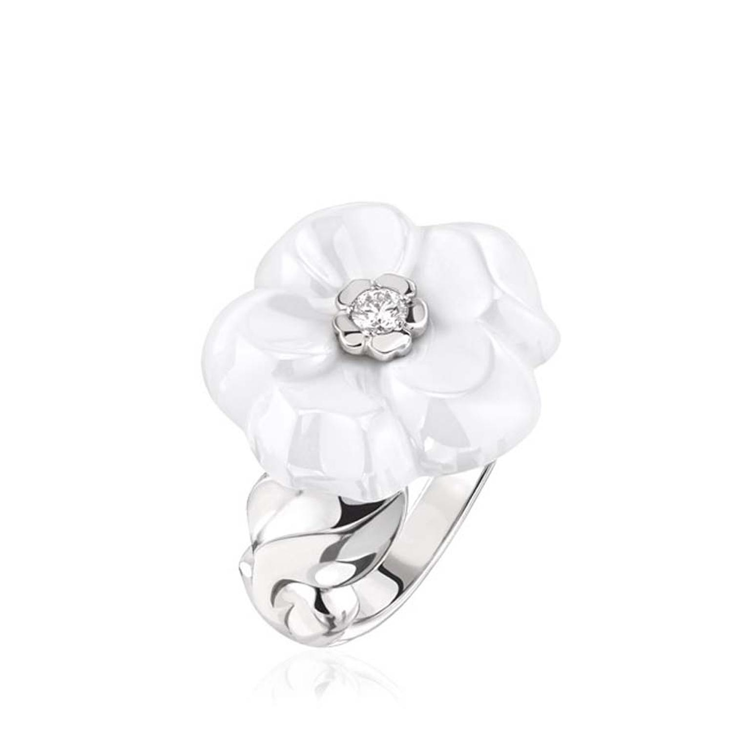Chanel Camélia Galbé white ceramic ring, with a gleaming brilliant-cut diamond at its heart.