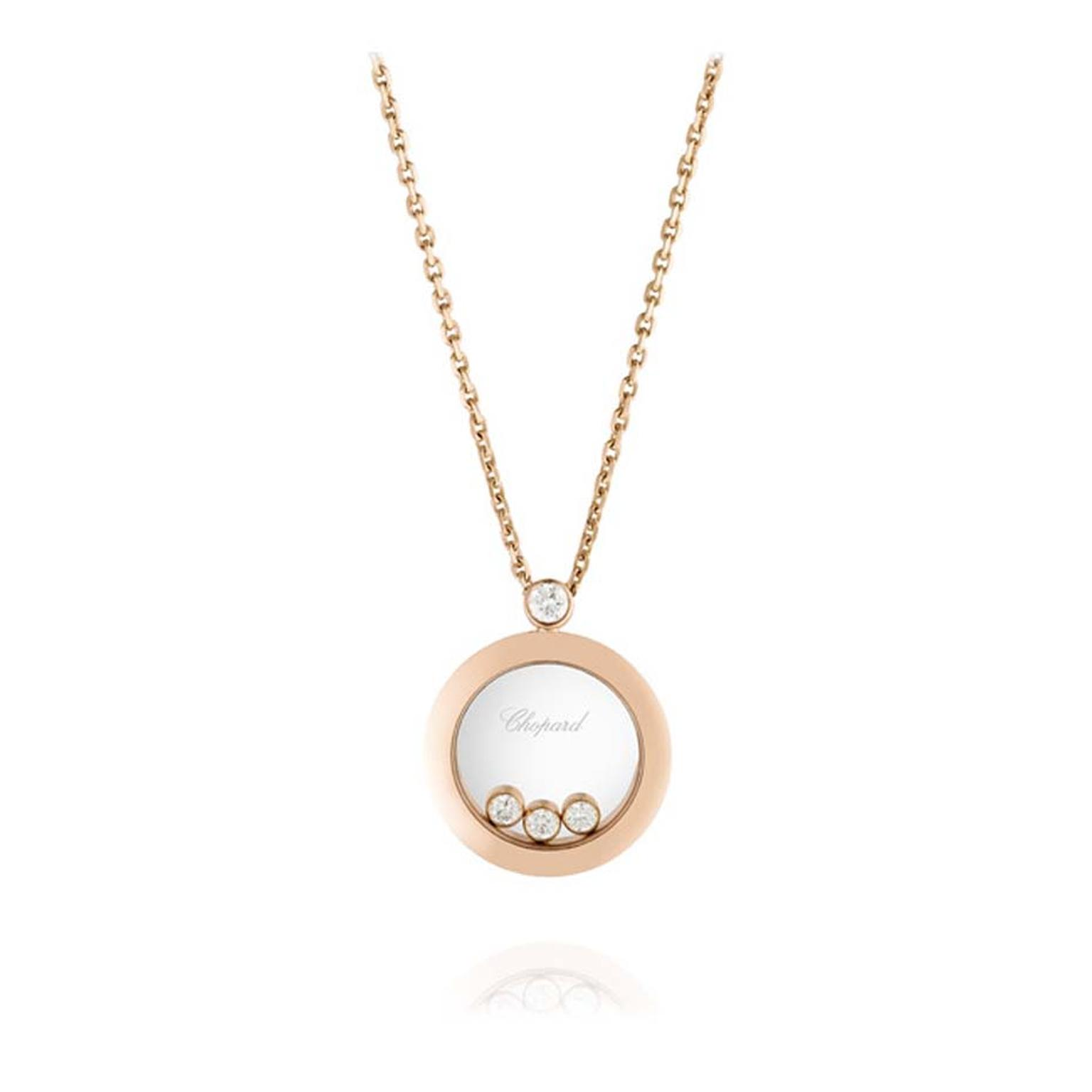 Chopard Happy Diamonds pendant, with three floating diamonds sat within a case of rose gold.