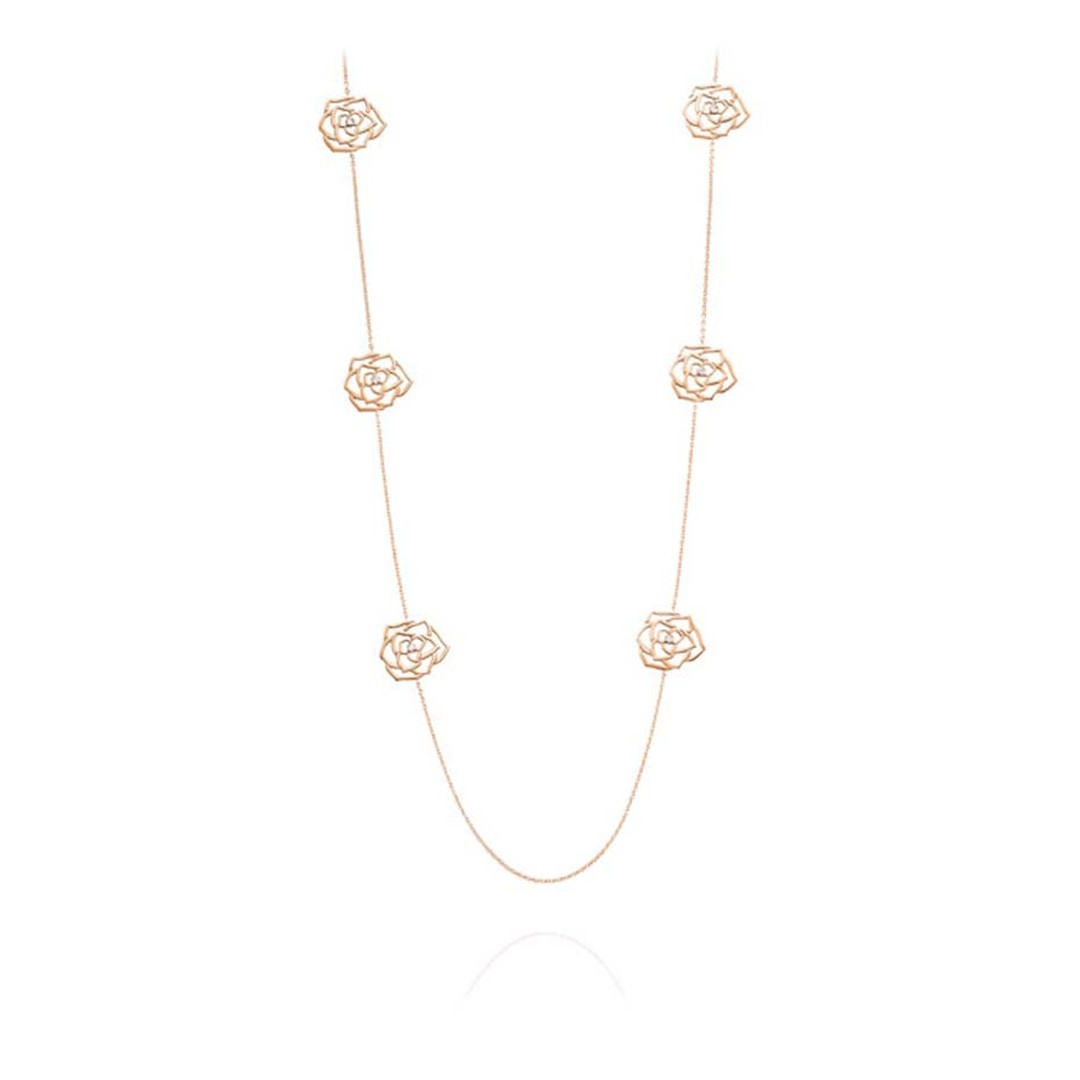 Piaget Rose necklace featuring the silhouettes of six Piaget roses in rose gold, each with a single diamond at its heart.