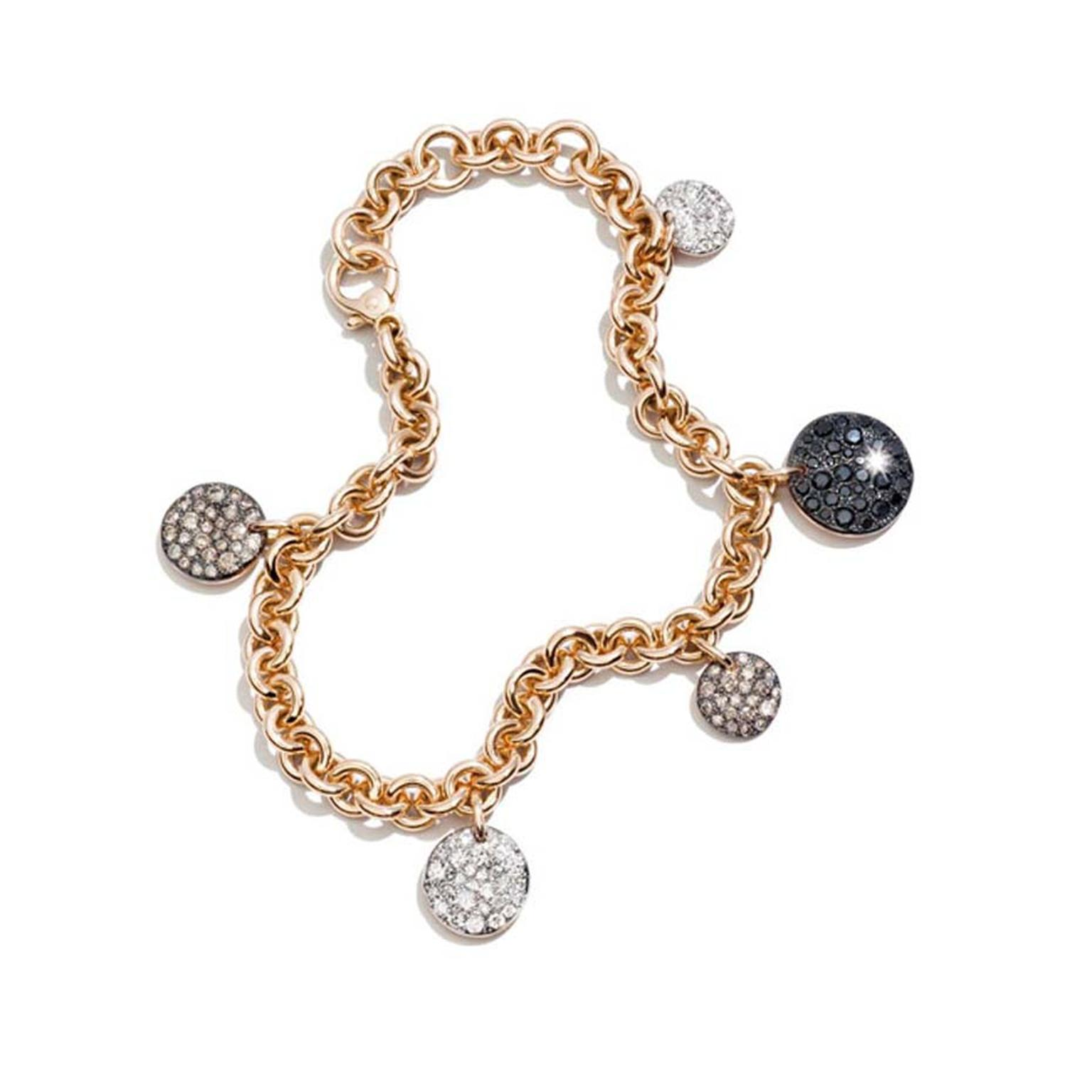 A special gift this Mother's Day - a piece of Pomellato jewellery. Rose gold and diamond Sabbia charm bracelet with discs of snow-set white, black and brown diamonds.