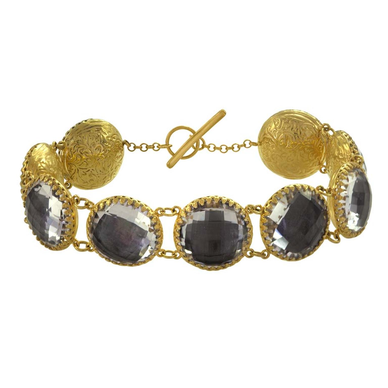 Larkspur & Hawk Olivia nine-stone button white topaz bracelet in yellow gold with grey foil ($2,250).