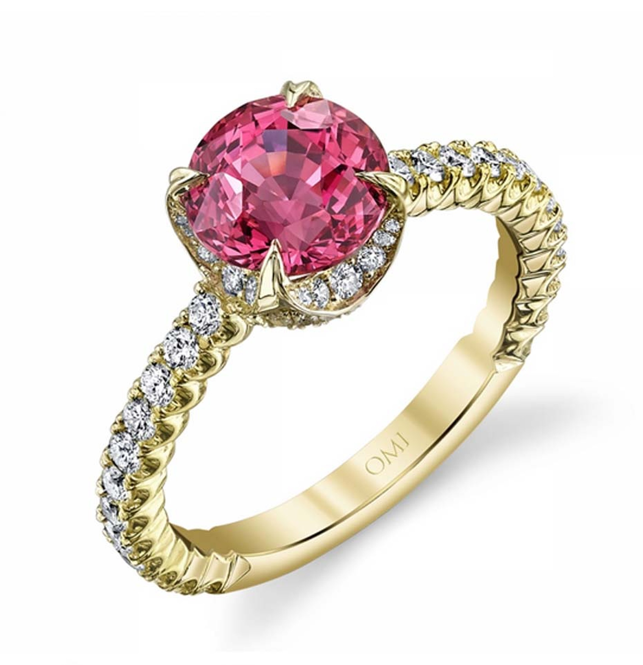 Omi Privé pink sapphire engagement ring featuring a round fancy-colour sapphire set in yellow gold with diamonds.
