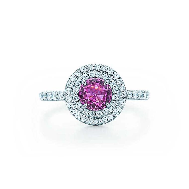 The circular diamond pavé design on this Tiffany pink sapphire engagement ring allows the vibrantly coloured gemstone to take centre stage.