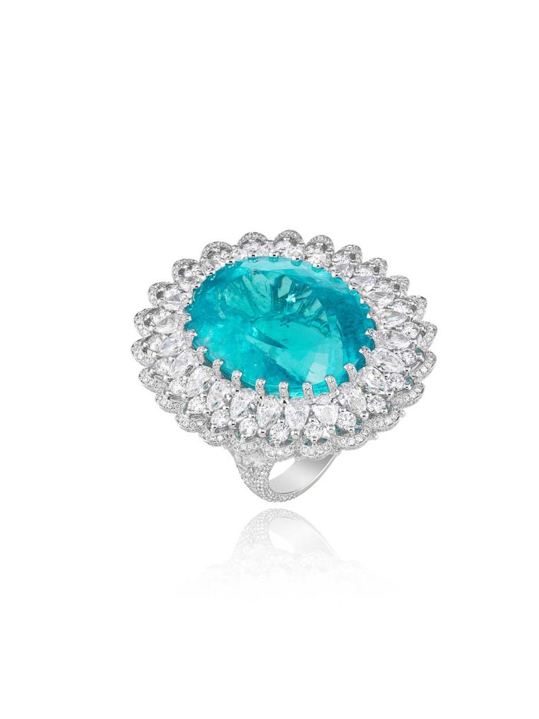 Chopard has taken advantage of the new source of Paraiba-like tourmalines from Africa to create an enormous 41.57ct oval-shaped tourmaline ring, with the lagoon-like precious stone encircled by a reef of pear-shaped and round diamonds.