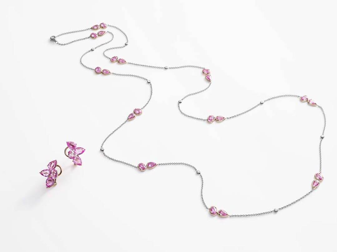This long sautoir-style pink sapphire necklace, pictured alongside pretty lobe-hugging earrings, from William & Son features pairs of pink sapphires in soft organic shapes and can be worn long or wrapped twice around the neck.