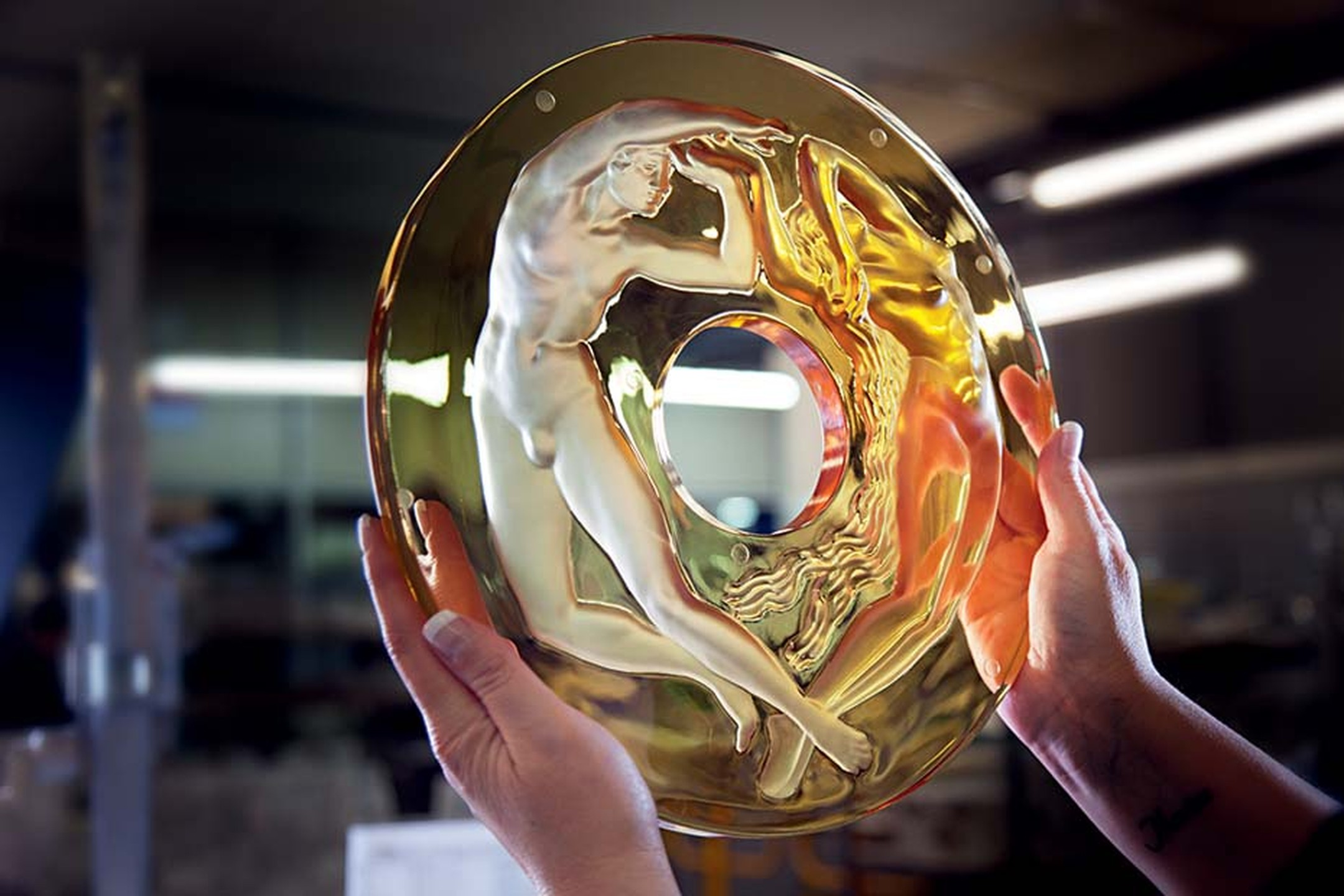 A glassmaker at Lalique inspects the crystal casing that will frame the Parmigiani clock.