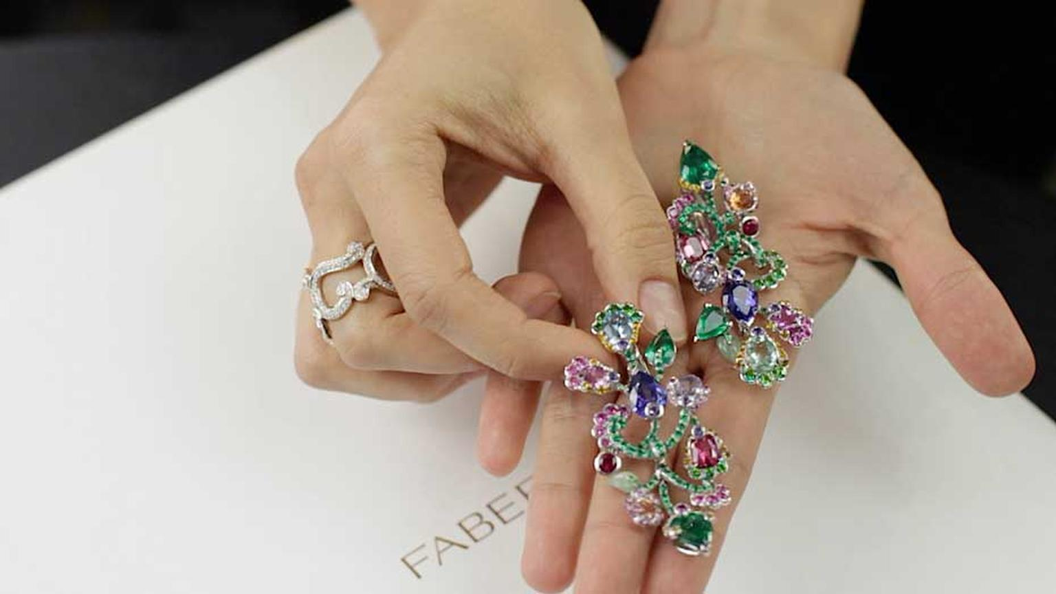 Fabergé earrings in the form of beautiful blossoms, gleaming with coloured gemstones.