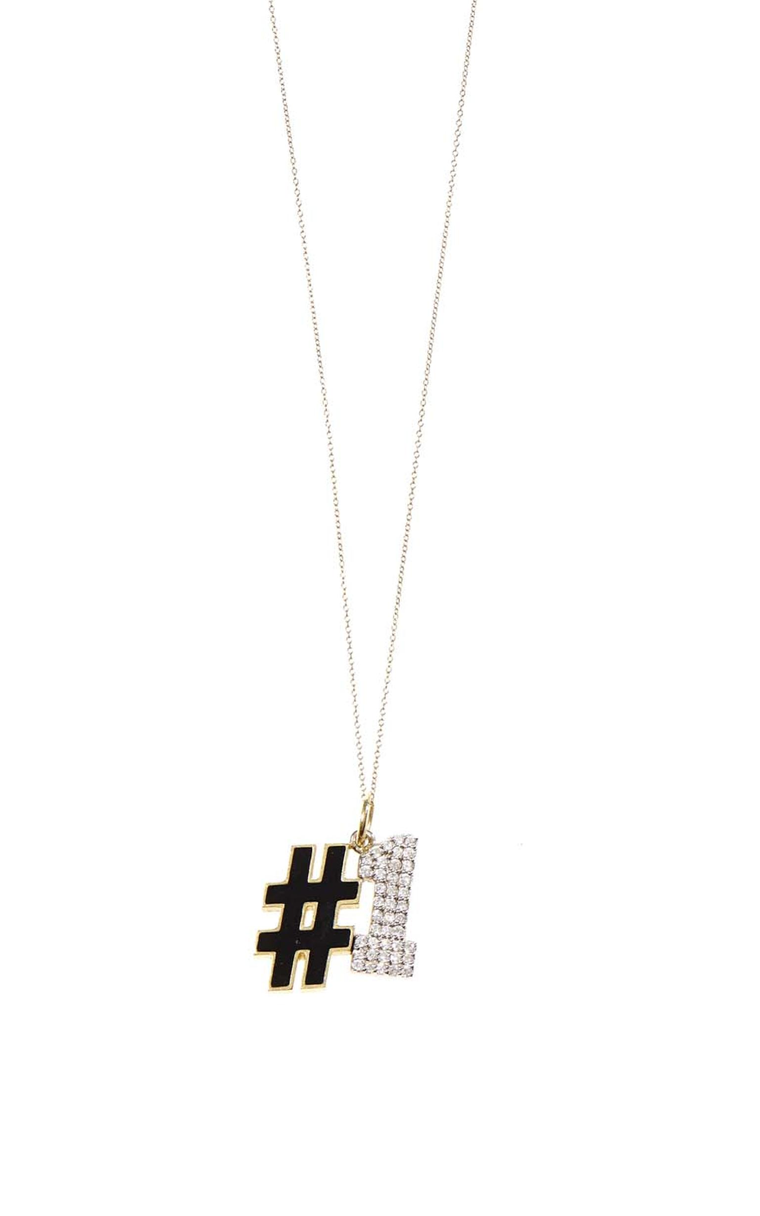 Show your mother she is still number one with this playful designer necklace from Alison Lou, featuring a black enamel hashtag and diamond-embellished number (£1,420, available at Matchesfashion.com).